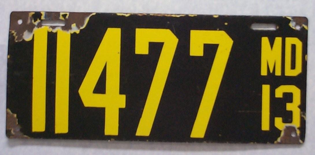 11477